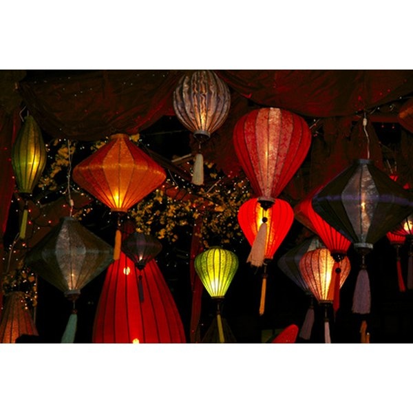 Lanterns add a festive glow to reception tents or the outdoors.