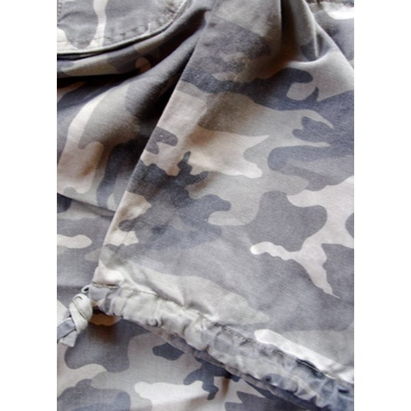 Camouflage fabric is designed to hide the wearer in a natural setting.