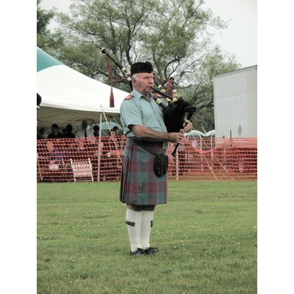 A Scottish piper wears a Glengarry bonnet.
