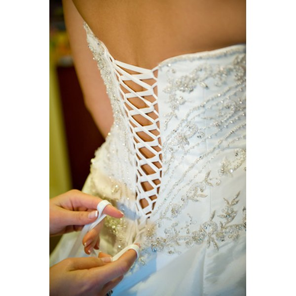 A girdle has lacing on the back, similar to a corset.
