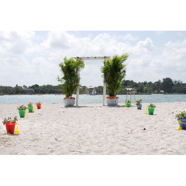 Use the natural ambiance of the beach as the primary decor for your beach wedding.