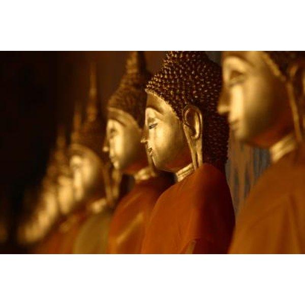 Row of golden Buddha statues.