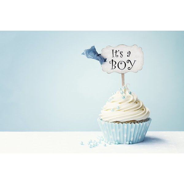Cupcake favors with personalized toothpick toppers mark a sweet occasion..