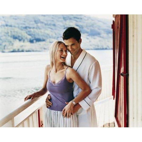 Couple embrace on balcony