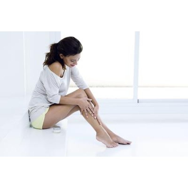 Woman feeling smooth legs
