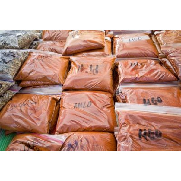Bags of mild and medium ground chipotle pepper at outdoor market
