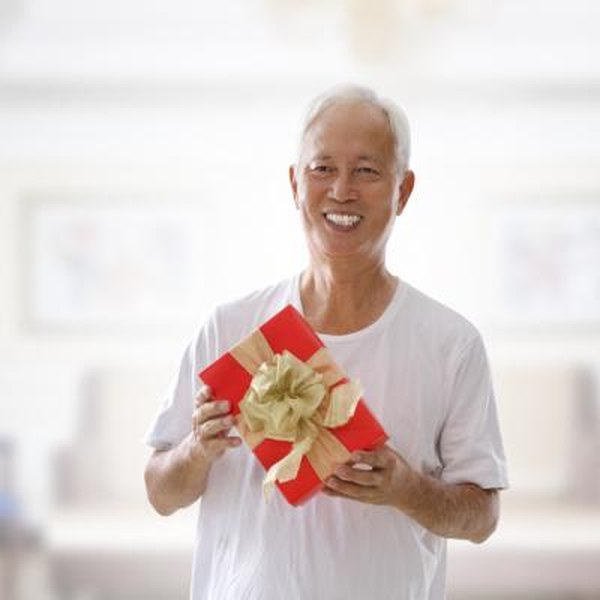 Senior man holds present