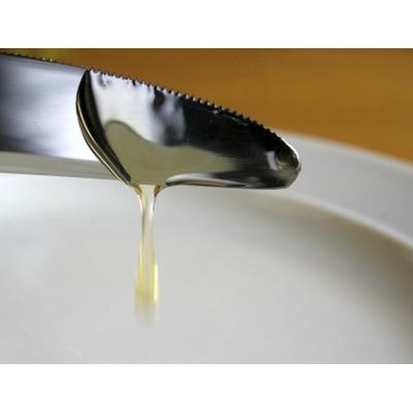 Corn syrup being added to bowl