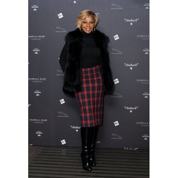Mary J. Blige pairs a tartan pencil skirt with a fur jacket and knee-high boots.