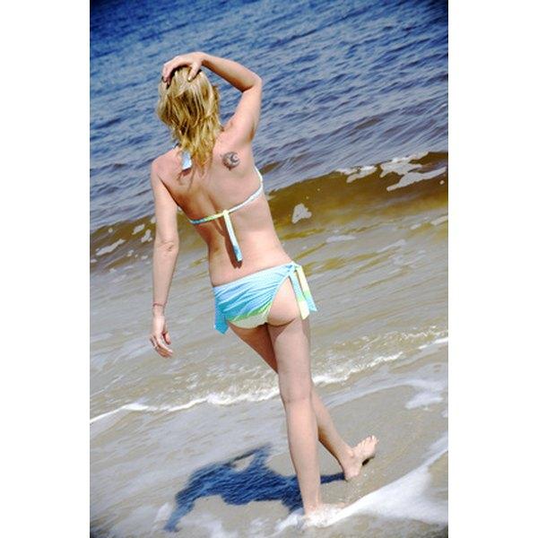 Get a smooth, hair-free bikini line by waxing.