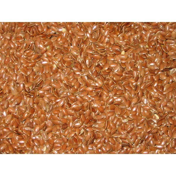 You should purchase ground flaxseed to use in your smoothies.