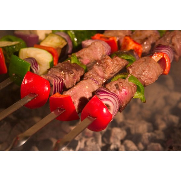Grill marinated kebabs over a barbecue pit for a succulent beach dish.