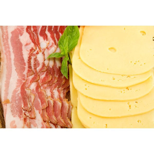 A diet rich in saturated fats, found in fatty meats and cheeses, increases the risk for hypertension and cardiovascular diseases.