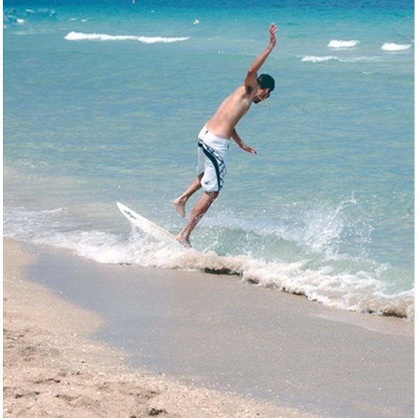 Pace your run onto your skimboard to help prevent falling.