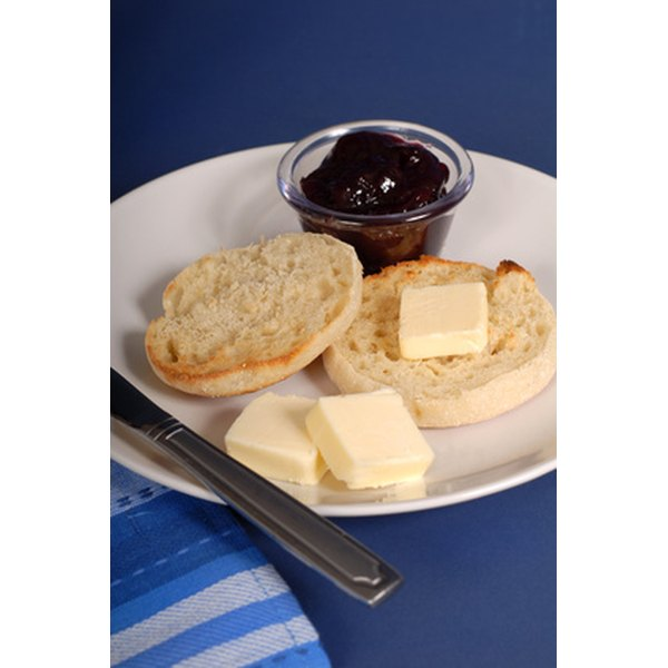 Serve English muffins with butter and jelly.