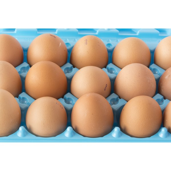 A carton with brown chicken eggs.