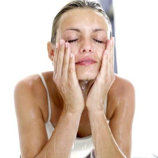 Woman washing face.