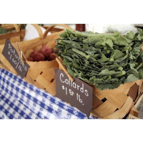 A basket of fresh collard greens at a farmer's market.