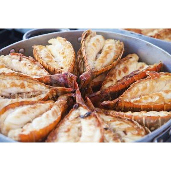 Grilled lobster tails in a bowl.