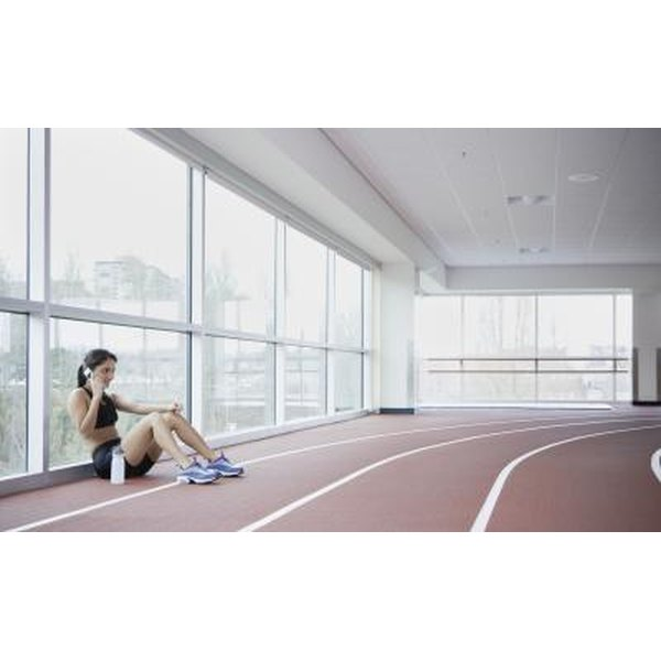 Woman resting from running in indoor track.