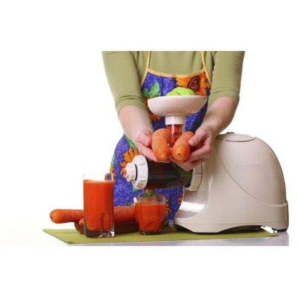 Woman with juicer.