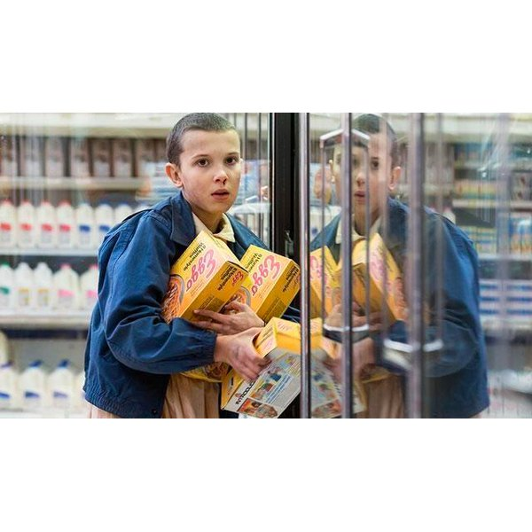 Eleven clears out the Eggo waffles from the freezer aisle.