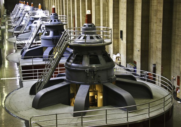 Giant turbines are often powered by steam from high-pressure boilers.