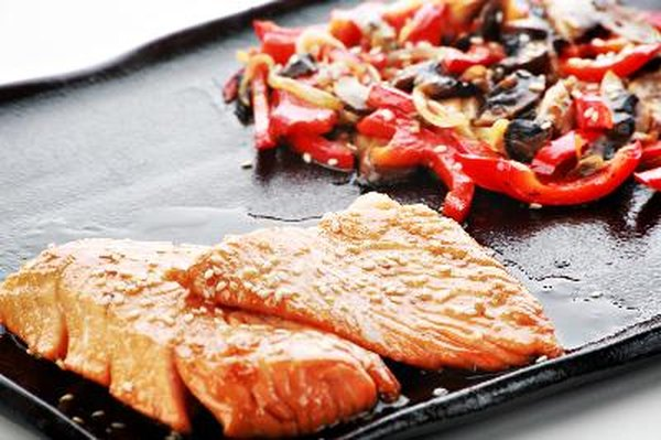 Salmon provides about 18 grams protein per 3-ounce serving.
