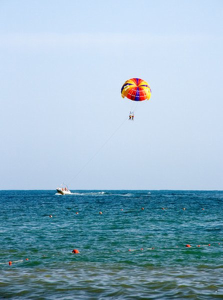 Parasailers are often seen along the coast.