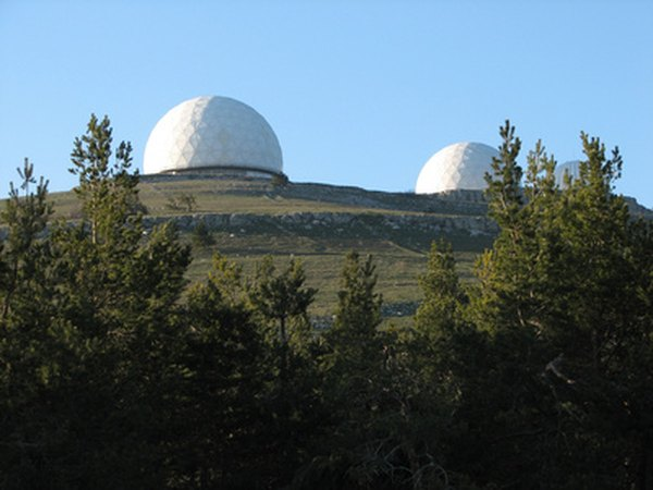 Observatories house optical telescopes for astronomical research.