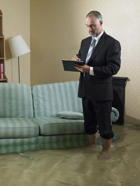 The insurance adjuster will take notes regarding all of the water damage in your home.