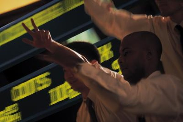 Stock traders buy and sell at a frenetic pace on the floor of stock exchanges.
