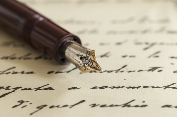 anink pen on top of cursive writing