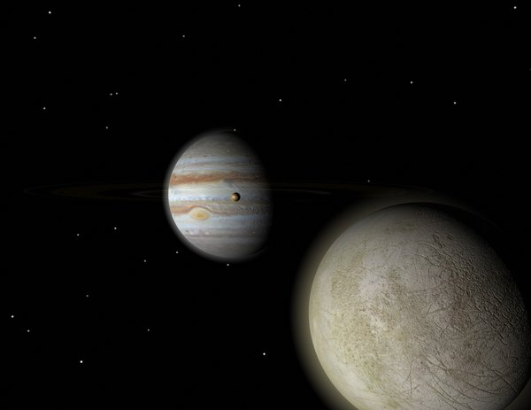 Europa and Io, two of Jupiter's moons, circle the planet.