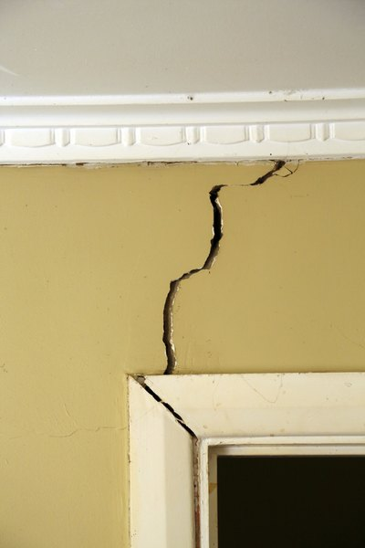 Sinking foundations cause cracking walls.