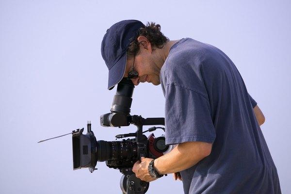 A man uses a digital video camera.