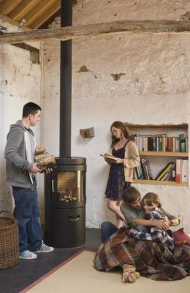 Wood-burning stoves provide an economic alternative to central-heat furnaces