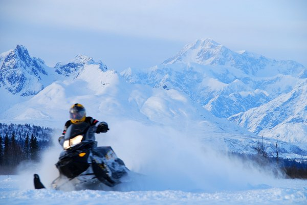 Snowmobiling is more exciting with Mount McKinley watching.