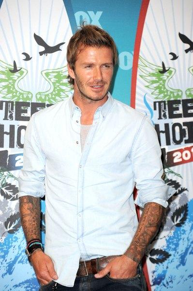 David Beckham posa para los fotógrafos.