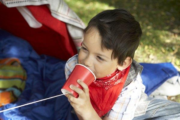 Boy talking on a string phone