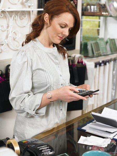 Woman using calculator at retail store