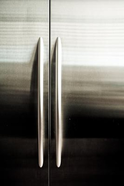 How to Hang Pictures on a Stainless Steel Refrigerator