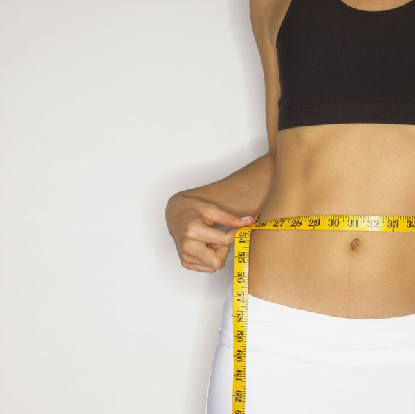 Exercises to Tighten Stomach Muscles - Woman
