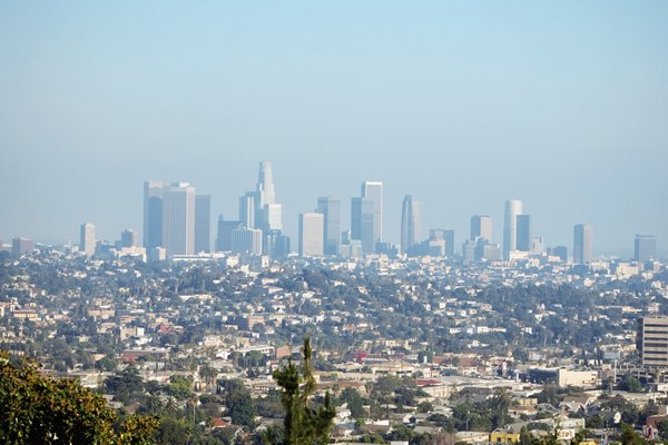 Downtown Los Angeles is  barely visible though a thick layer of pollution.