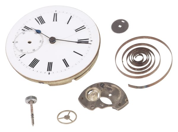 Pieces of a clock with electromagnet and coil.