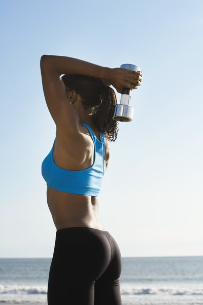 lying tricep extension vs standing dumbbell woman