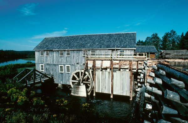 Water wheel at a rustic lumber mill in Sherbrooke, Nova Scotia, Canada.