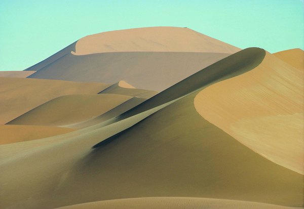 As a coastal desert, the Namib Desert in South Africa has sand dunes tainted with salt.