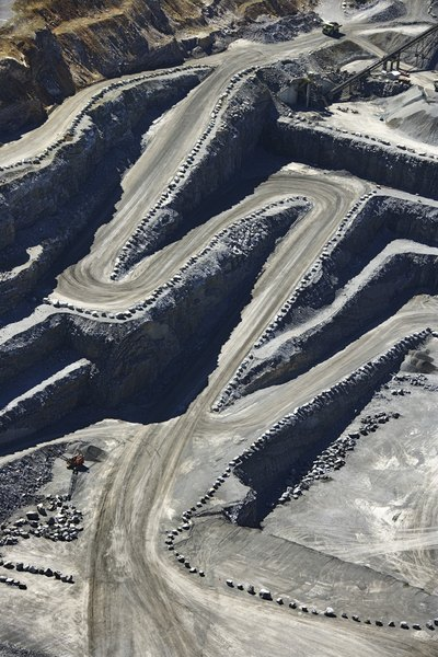 Strip mining requires the removal of soil and vegetation.