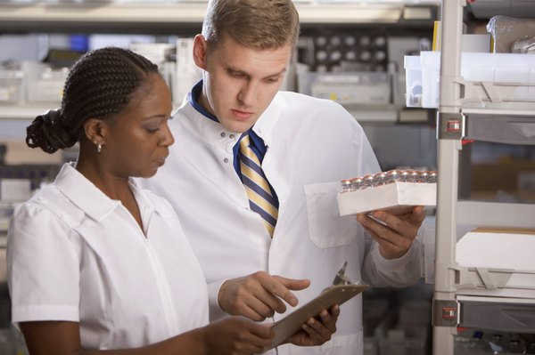 Lab Technicians Work And Closely Analyze Test Results.
